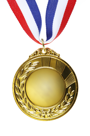 Closeup of golden medal on plain background Stockfoto