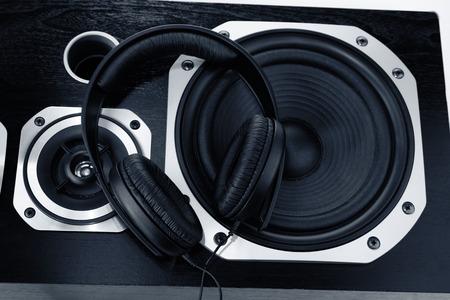 entertainment equipment: Headphones on stereo speakers