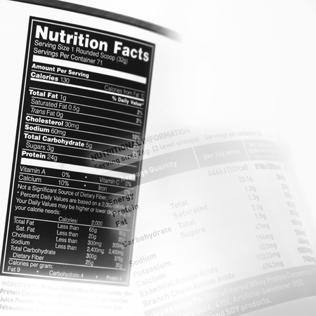 nutrition label: Nutrition information facts on assorted food labels Stock Photo