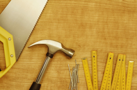 space wood: Hammer, nails, ruler and saw on wood. Copy space