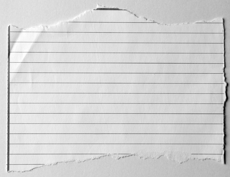 lined paper: Piece of torn lined paper Stock Photo