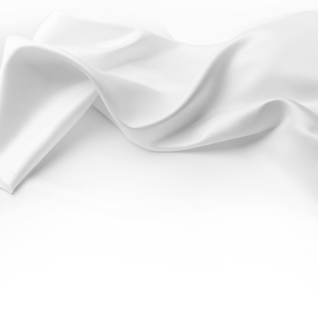 Closeup of rippled white silk fabric. Advertising copy space
