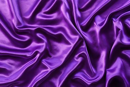 satiny: Closeup of rippled purple silk fabric