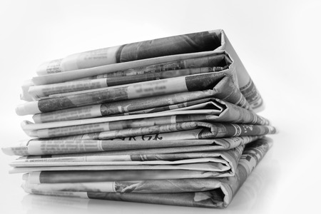 read news: Closeup of pile of newspapers