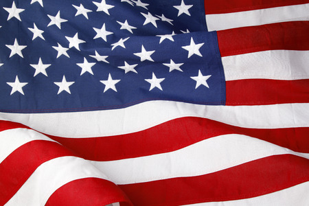 the united states flag: Closeup of ruffled American flag