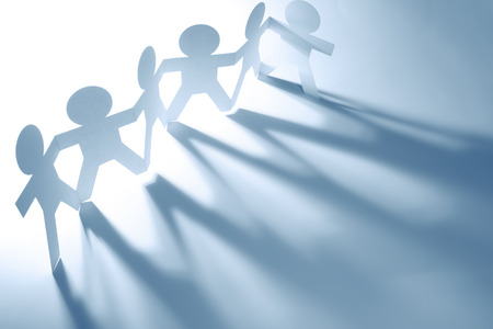 people shadow: Team of paper doll people casting shadows. Blue tone. Stock Photo
