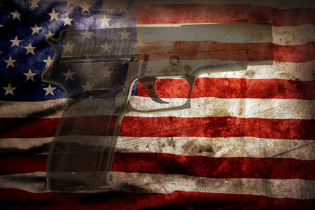 ハンドガンとアメリカの旗 写真素材
