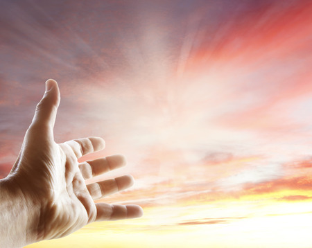 spiritual: Hand reaching for the sky