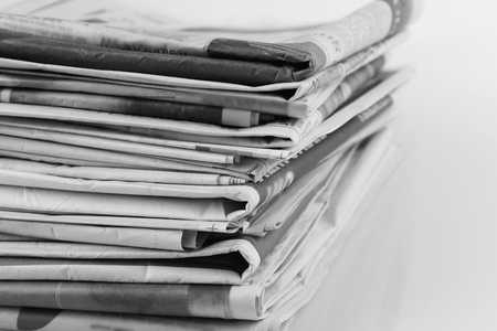 heaped: Closeup of pile of newspapers