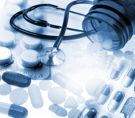 a medical technology: Stethoscope and assorted pills