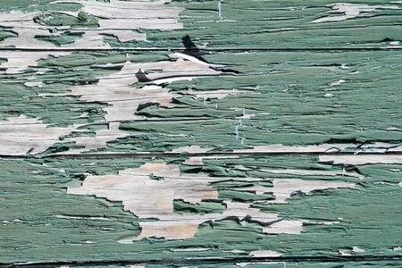 flaking: Closeup of green flaking paint on boards Stock Photo