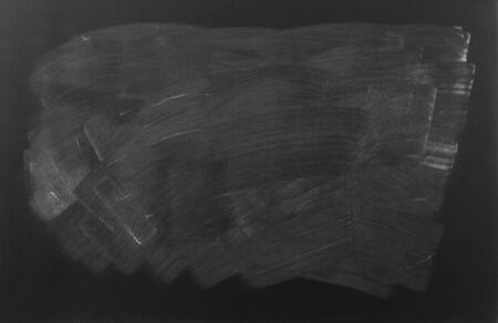 abstract black: Chalk rubbed out on blackboard