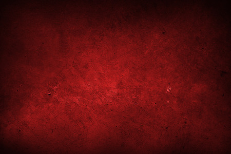 Red grunge textured wall, dark edges
