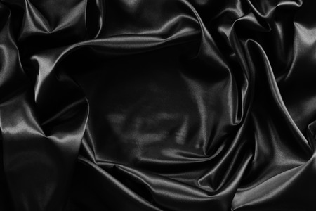 shiny black: Closeup of rippled black silk fabric