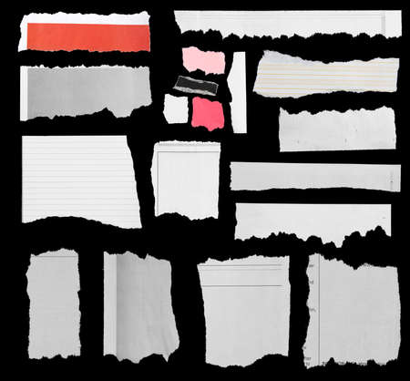 torn paper: Pieces of torn paper on black