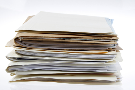 filing document: Pile of files on plain background