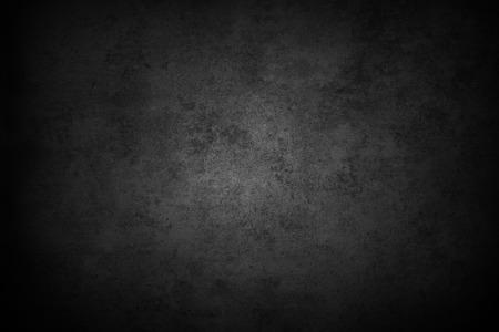 Dark textured grey wall closeup