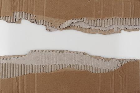 torn edge: Hole ripped in corrugated cardboard Stock Photo
