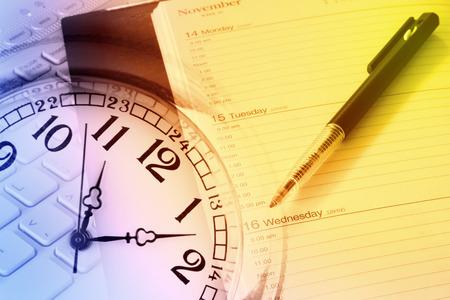 cronogramas: Pen, diary, clock and computer keyboard