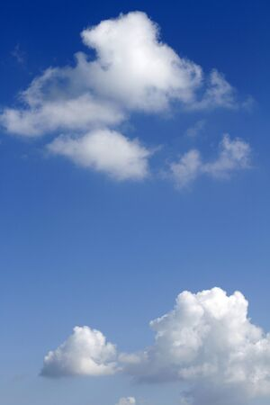 blue sky: Fluffy clouds in a blue sky Stock Photo