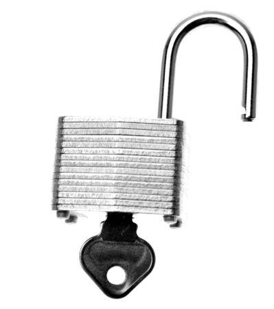 unleash: Open padlock and key on plain background Stock Photo