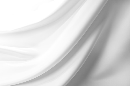 Closeup of rippled white silk fabric Standard-Bild