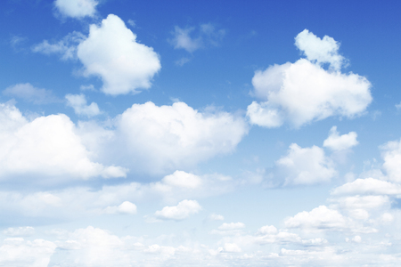 fluffy: Fluffy white clouds in sky Stock Photo