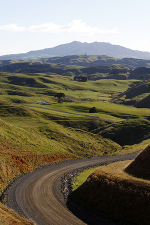 country road: Looking down valley in New Zealand Stock Photo