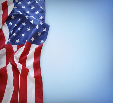 Amerikaanse vlag op een blauwe achtergrond Stockfoto