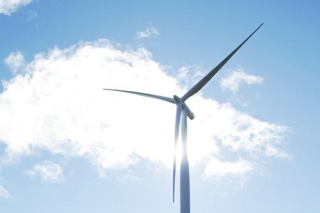 renewable: Giant wind turbine and blue sky Stock Photo