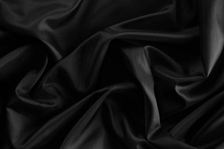 tela seda: Primer plano de la tela de seda negro ondulado