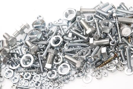 metal fastener: Chrome nuts and bolts closeup