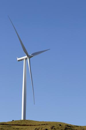 windy energy: Giant wind turbine on hill