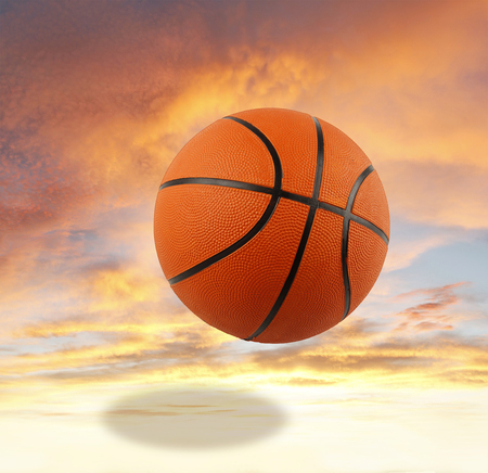sport object: Basketball bouncing in the sky