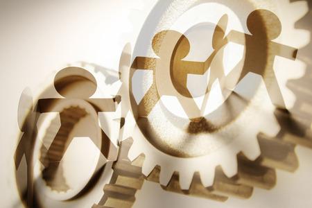 teamwork concept: Gears and team. Teamwork concept Stock Photo