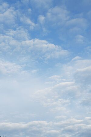 fluffy clouds: Fluffy clouds in a blue sky Stock Photo