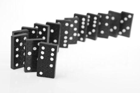 dominoes: Dominoes standing on plain background