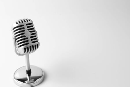 entertainment equipment: Old classic microphone on plain background