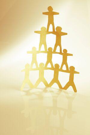 piramide humana: Pirámide de equipo humano de la mano
