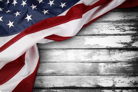 Closeup of American flag on wooden background Foto de archivo
