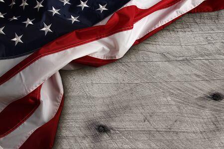 banderas america: Closeup of American flag on wooden background Foto de archivo