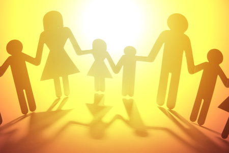 warmth: Family paper chain cutout holding hands Stock Photo