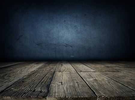 floorboards: Wooden floorboards and blue wall