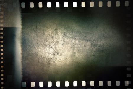 negative spaces: Film negative frames on grunge background