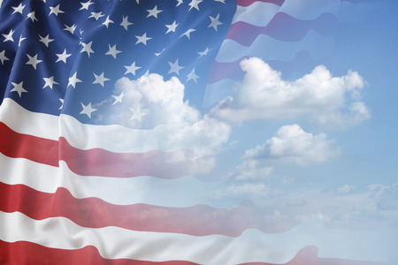 American flag in blue sky 스톡 콘텐츠