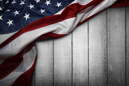 Closeup of American flag on wooden background Stockfoto