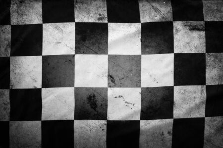 old flag: Grungy checkered black and white racing flag