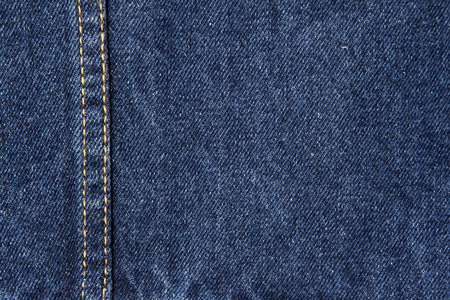 blue denim: Closeup of blue denim fabric