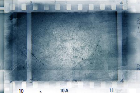 negative: Film negative frames on blue background