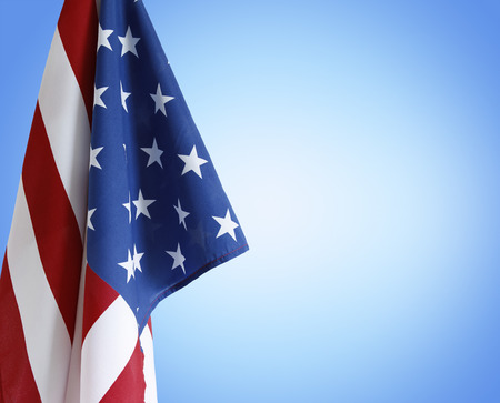 American flag in front of blue background 版權商用圖片